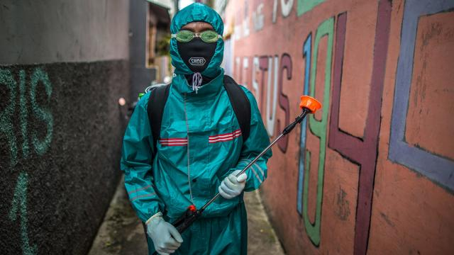 A volunteer, posed before spraying disinfectants in a public area in Jakarta, Indonesia on 27 March 2020.